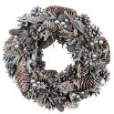 Silver berrys, pinecones and pine foliage in wreath shape on white background